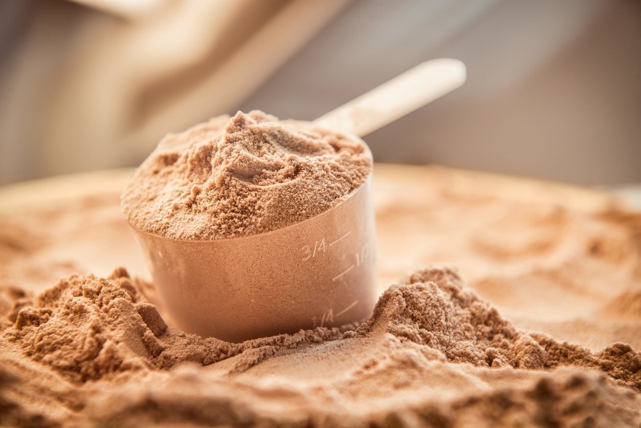 Whey protein in a scoop
